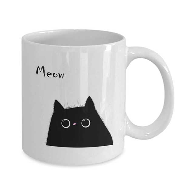 A black and white cat mug with Meow quote on Amazon