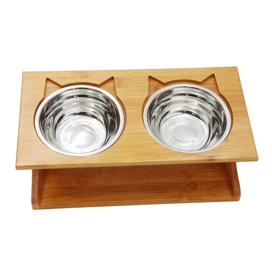 a dining table with two stainless steel bowls for cats