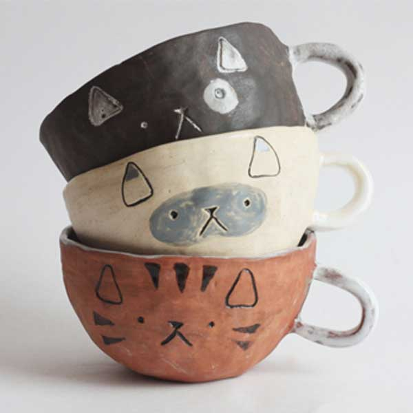 A set of hand made cat cups on Etsy for cat lovers and owners