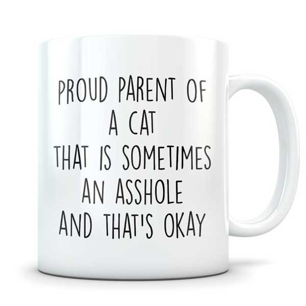 A cute white coffee mug for cat parents on Etsy