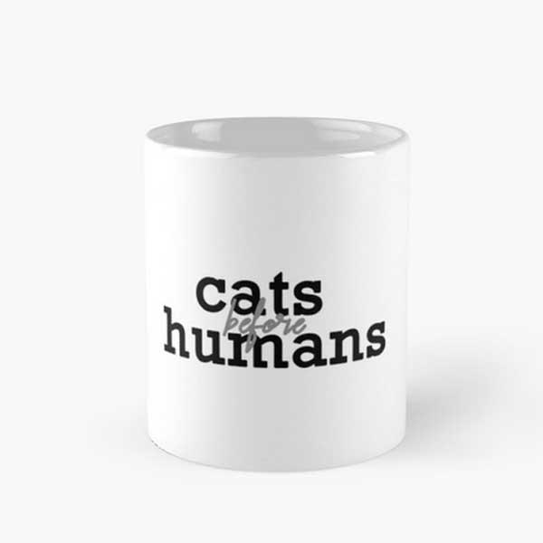 A cat coffee mug with a cute saying