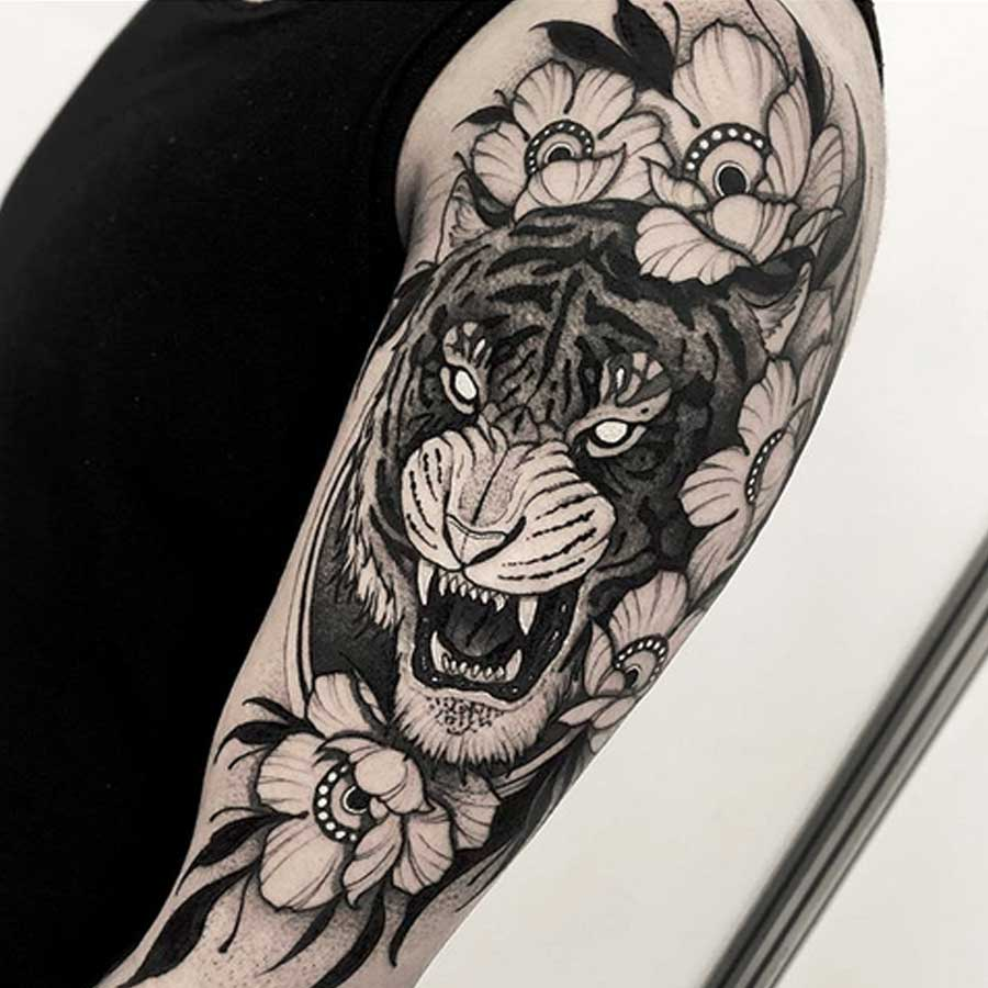 A wild cat black and white tattoo by Franki Tattoo