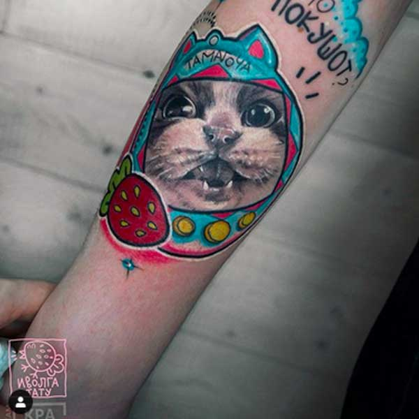 A cartoon cat tattoo by ivolgatattoo