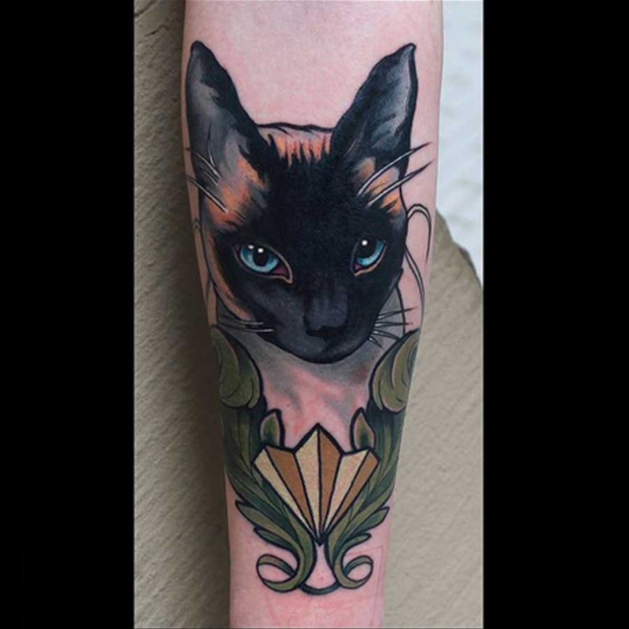A black cat portrait tattoo by Brian Povak
