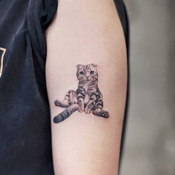 Black and white tattoo of sitting cat by AkiWong