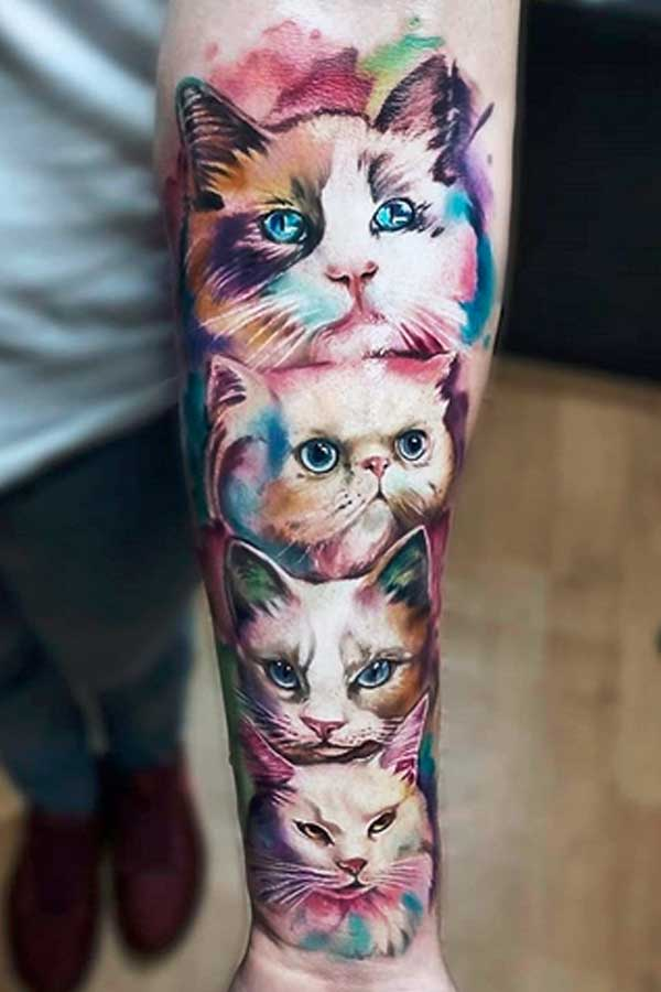 Colour tattoo of cat faces by VINNI MATTOS TATTOO