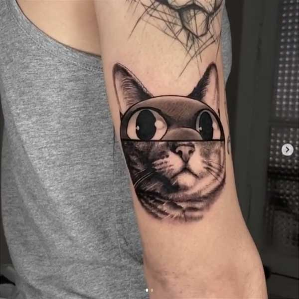 Neo traditonal black and white cat face tattoo by Mat Rule