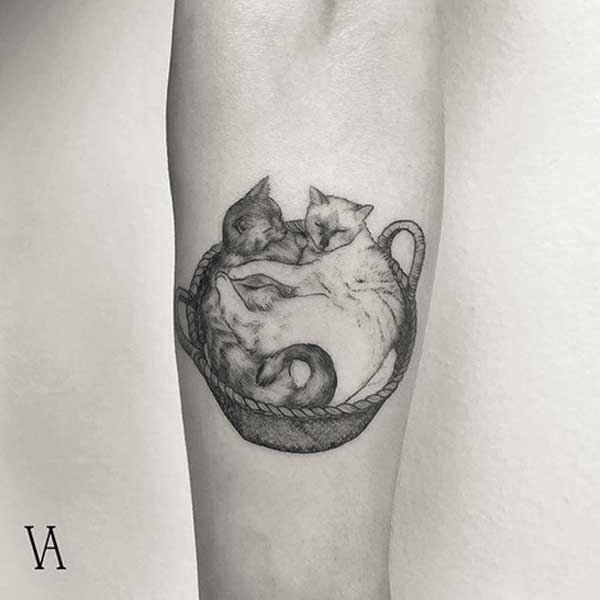 Traditional tattoo of sleeping cats by Violeta Arús