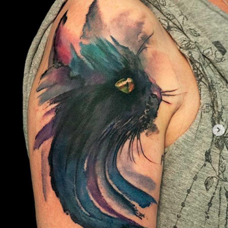 A watercolour black cat tattoo by artist alexalvaradotattoos