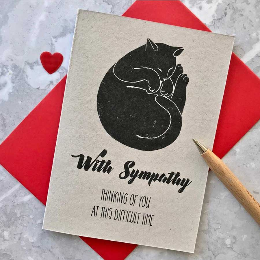 A cat sympathy card with a black sleeping cat and words thinking of you as this difficult time