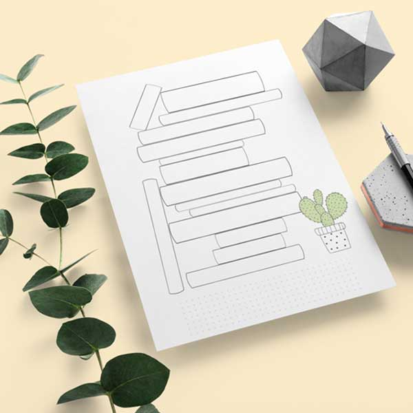 A digital book tracker template with green leaves, pen, and a grey cube
