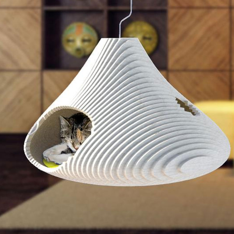 A cat is sleeping in sculptural hammock that mimics the natural place where cats like to hide