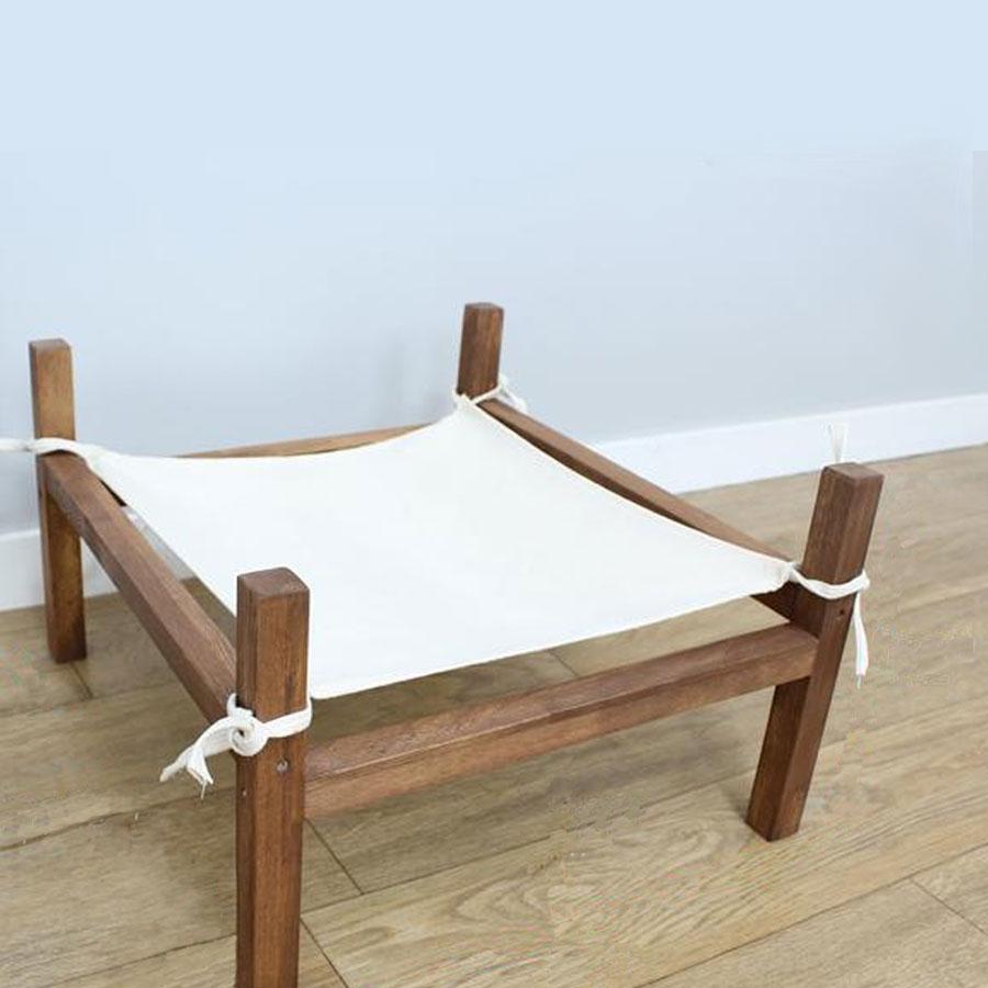 A minimalistic wooden cat hammock