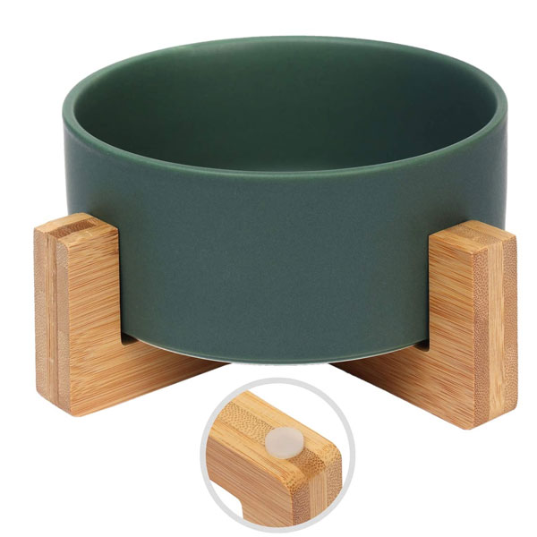 a green ceramin bowl on bamboo stand for cats designed by Olsa