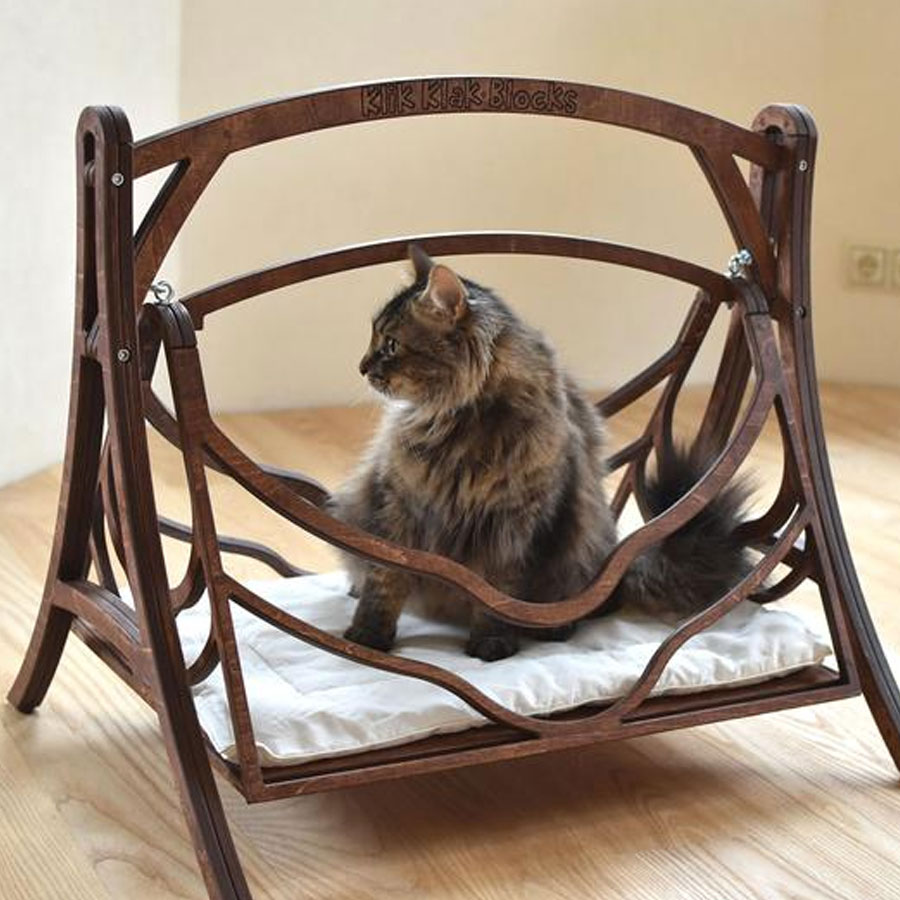 A wooden retro cat swing bed with a grey cat in it