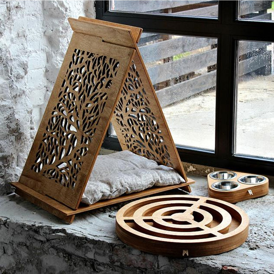 A stylish wooden set for cat including a hammock with cursion, bowls, and toys