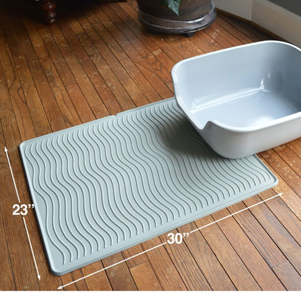 cat litter box and mat in pastel blue color on wooden floor